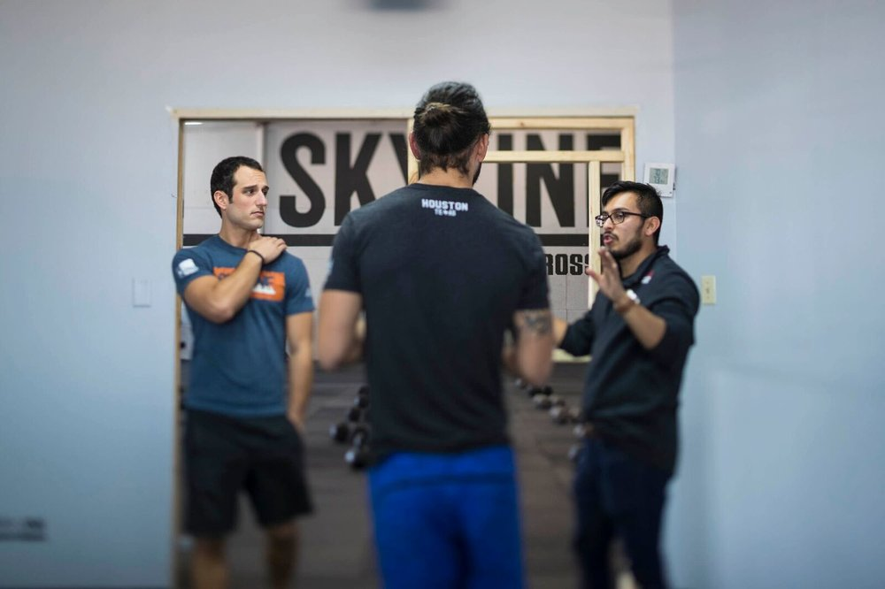 CrossFit Production going over shoot with the coaches.