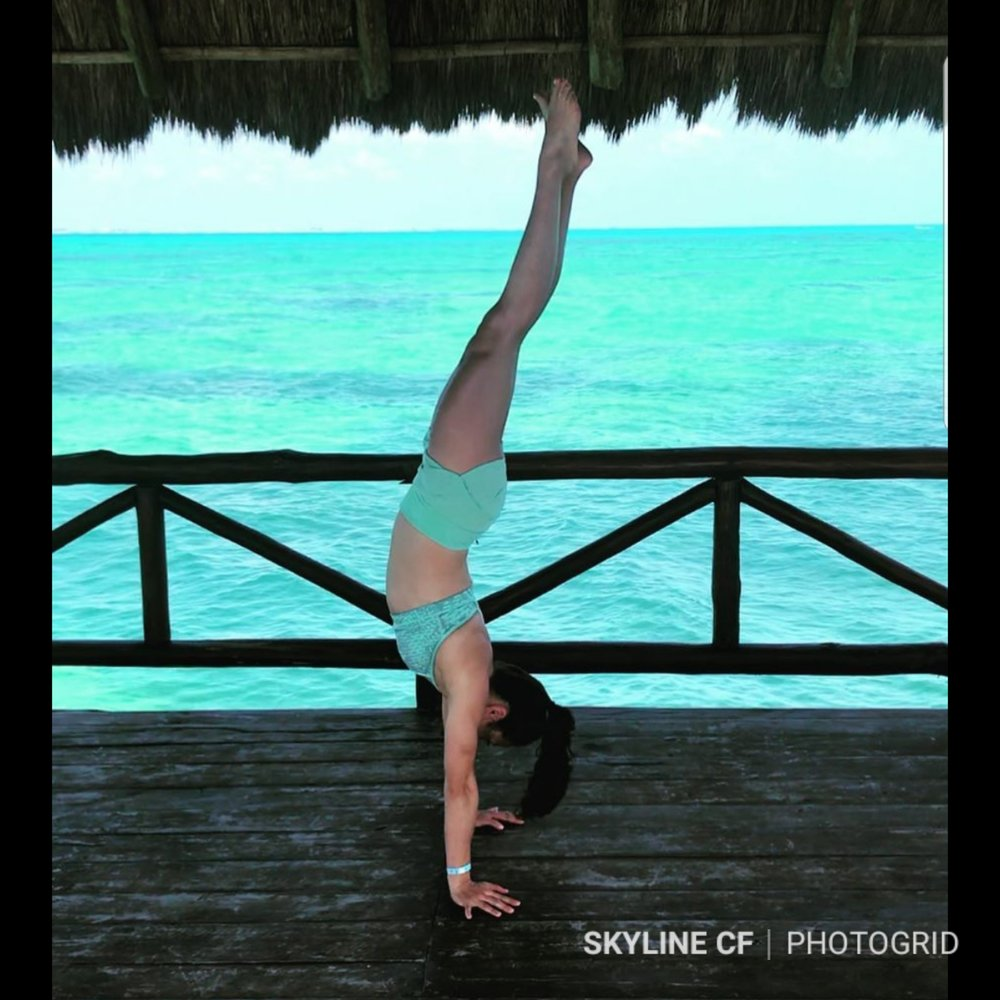 Coach Isabel showing off her Handstand skill in the Caribbean.