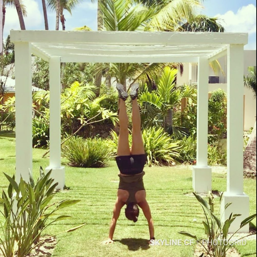 Coach Isabel getting her handstand work in paradise.
