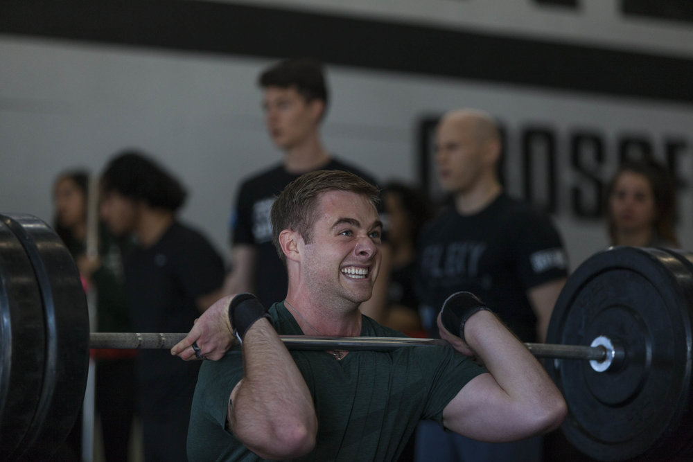 Grant feeling the 5-rep front squat during Granite Games.