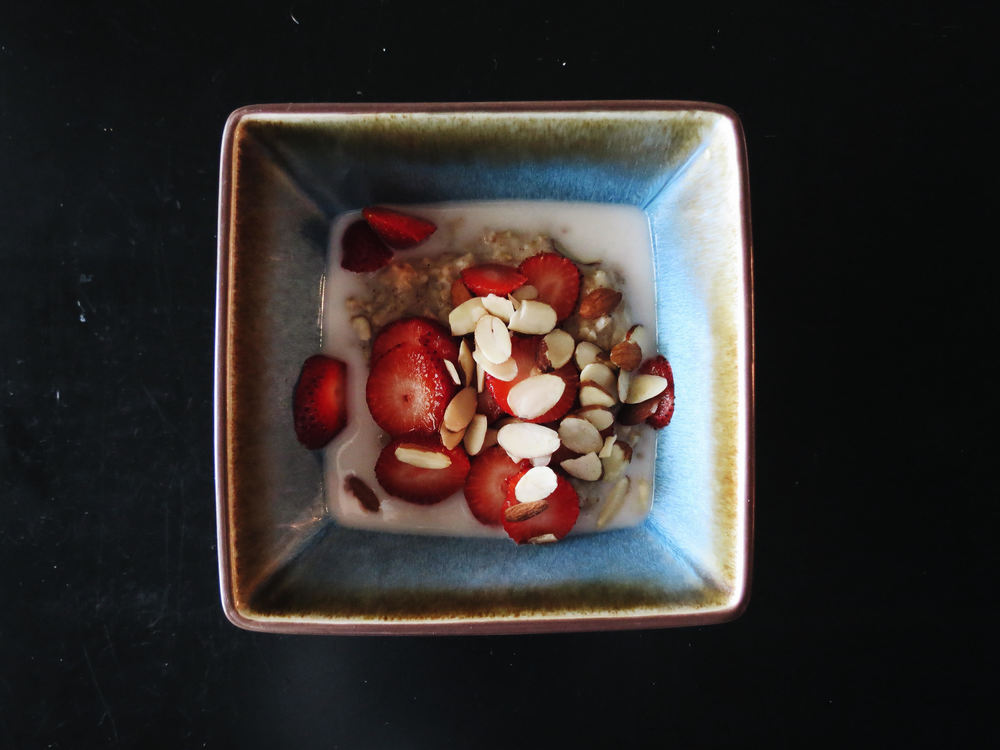 gluten-free, steel cut oats w/ strawberries, almonds + almond/coconut milk