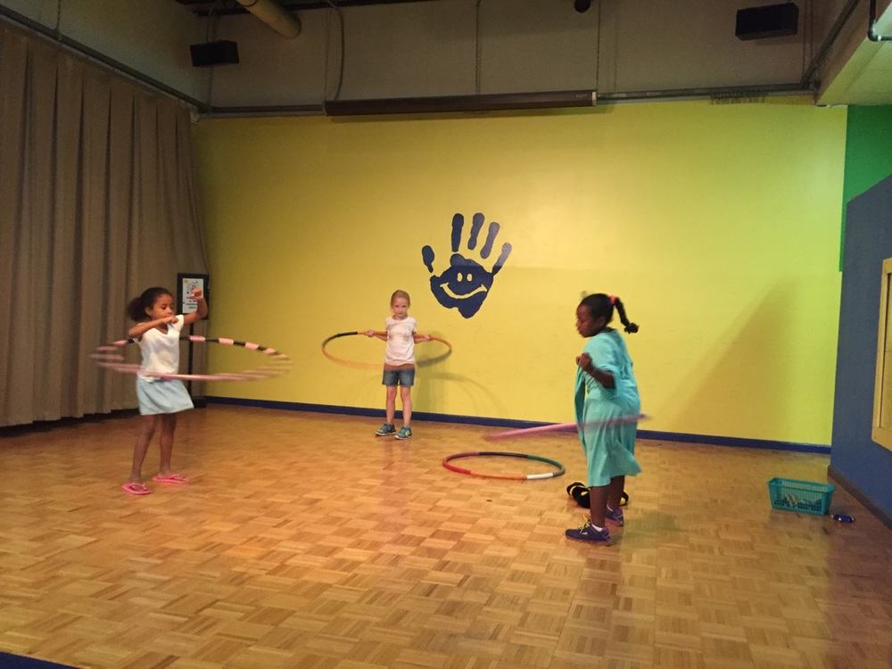 All dressed up and hula hooping at Hands On!