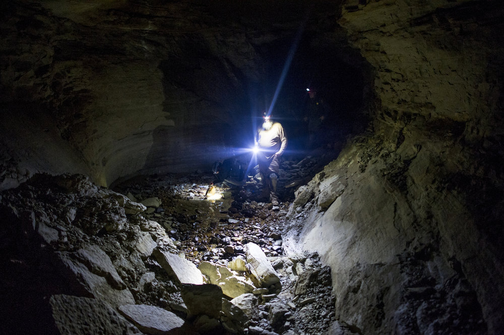 Chris Clark, a Mammoth Cave National Park employee, continues through Bat Cave, named for the hundreds of years of bat bones found here, a sign that it was once a large hibernaculum.