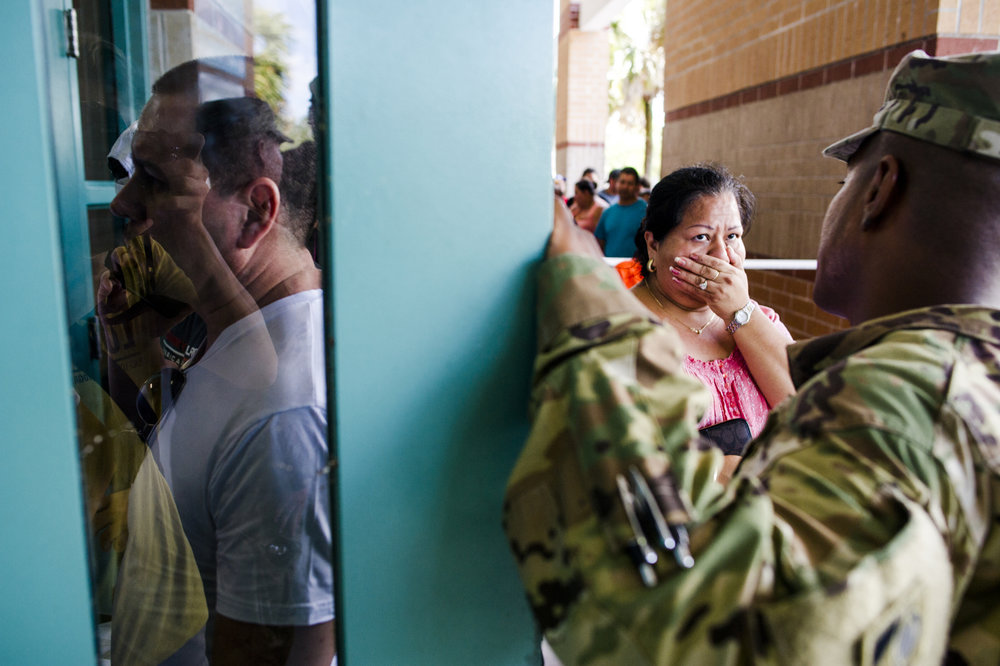 A woman is denied entrance to a shelter.