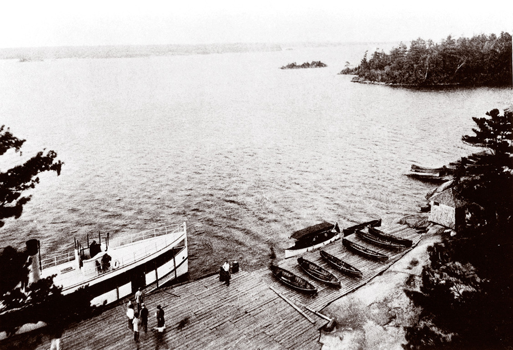 Once hotel guests had settled in, they were invited to explore local channels and islands in one of the Ojibway's comfortable launches (left), featuring custioned seats and elegant awnings which protected fair complexions from the sun. More adventurous guests could ply the waters on their own, enjoying the majestic scenery of Georgian Bay from the less-shaded and not-quite-so-comfortable seats of one of the hotel's rowboats (top).