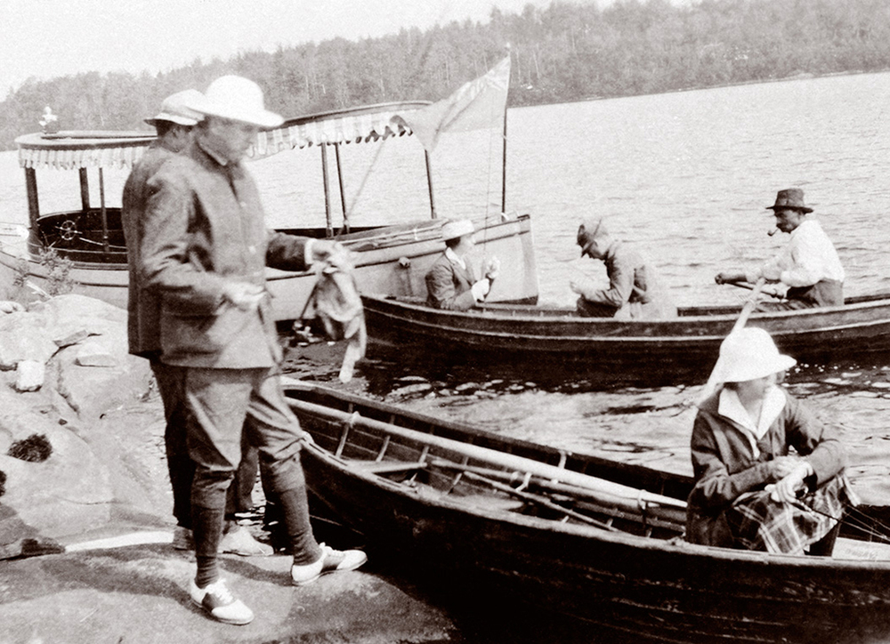 On Ojibway fishing expeditions, rowboats were often towed behind the hotel's launch. Once at the chosen destination, guests could row on their own among the islands to catch their daily limit. A highlight of the outings was the shore lunch, prepared for guests by the guides.