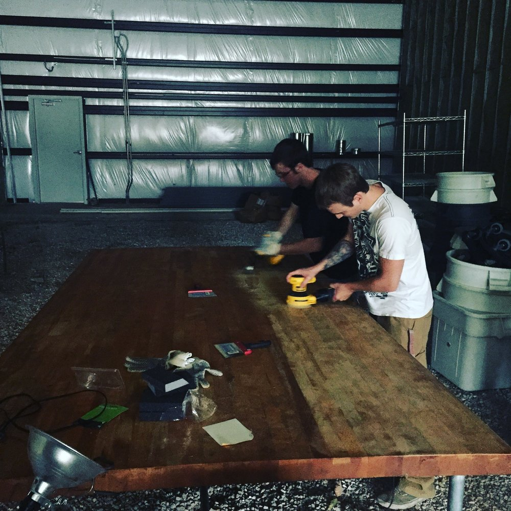 Two of our bakers came in to sand down and refinish our bakers table. This beauty is 10 feet long and weighs right around 1000 lbs. It took 8 guys to carry it into the space.