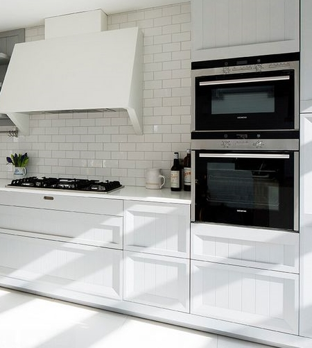 Built-in-appliances-and-white-subway-tiles.jpg