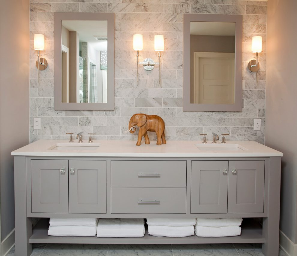 Carrara-marble-baseboard-bathroom-beach-style-with-white-trim-freestanding-vanity-subway-tile-backsplash.jpg