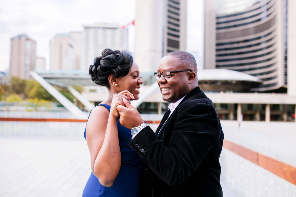 African Canadian Kenyan Engagement Shoot Nathan Phillips square Toronto sign Old City Hall Engagement Photography Toronto Kenyan Kenya Osgoode Hall Toronto Downtown location Photographer Elegant photo ideas Ontario Canada African Black Couple Best Photographer Karimah Gheddai Photography Dancing