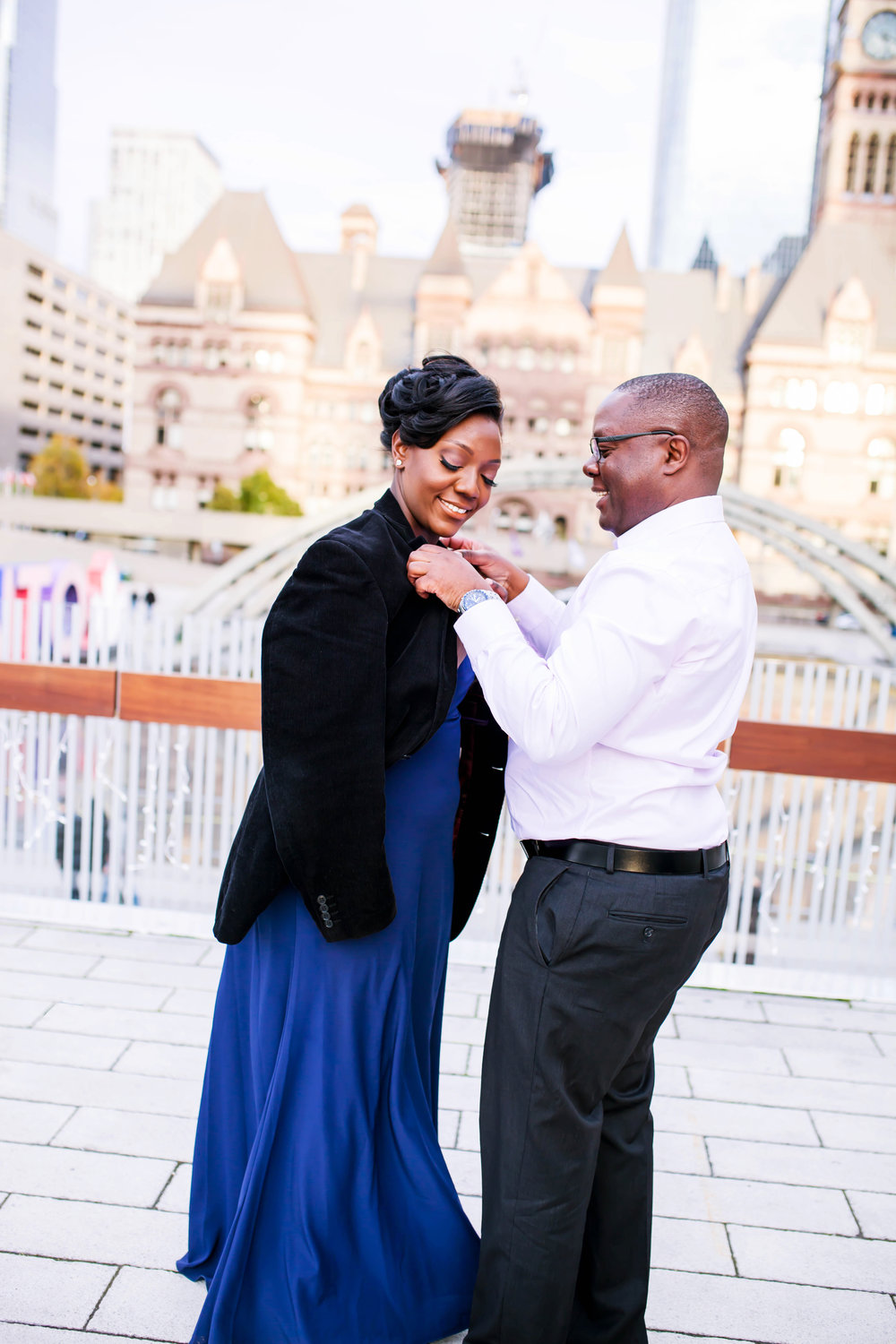 African Canadian Kenyan Engagement Shoot Nathan Phillips square Toronto sign Old City Hall Engagement Photography Toronto Kenyan Kenya Osgoode Hall Toronto Downtown location Photographer Elegant photo ideas Ontario Canada African Black Couple Best Photographer Karimah Gheddai Photography Futuristic Architecture
