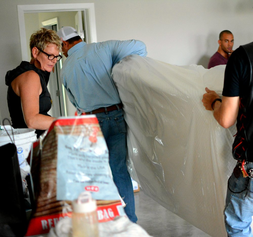 The first mattress as it was being carried into the first cottage at The Refuge Ranch.