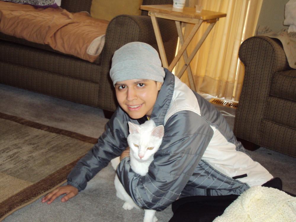 Alyssa hugs snowball.JPG