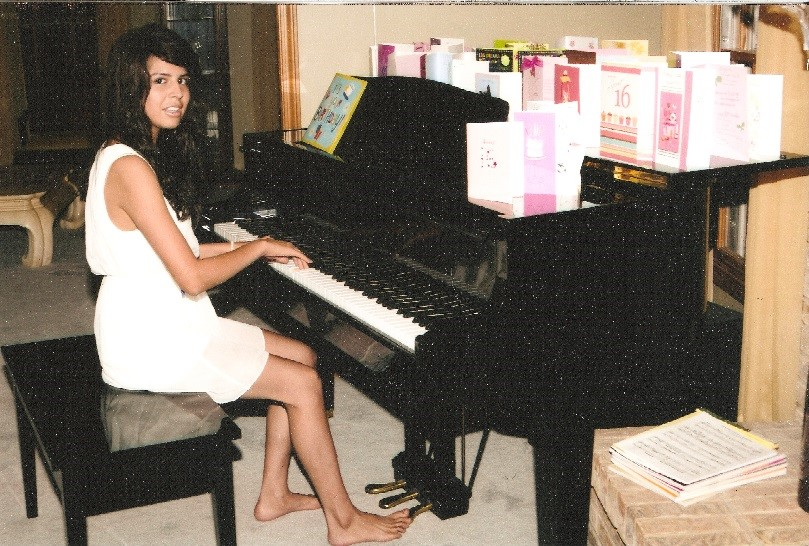 Alyssa playing her piano at home on her 16th birthday