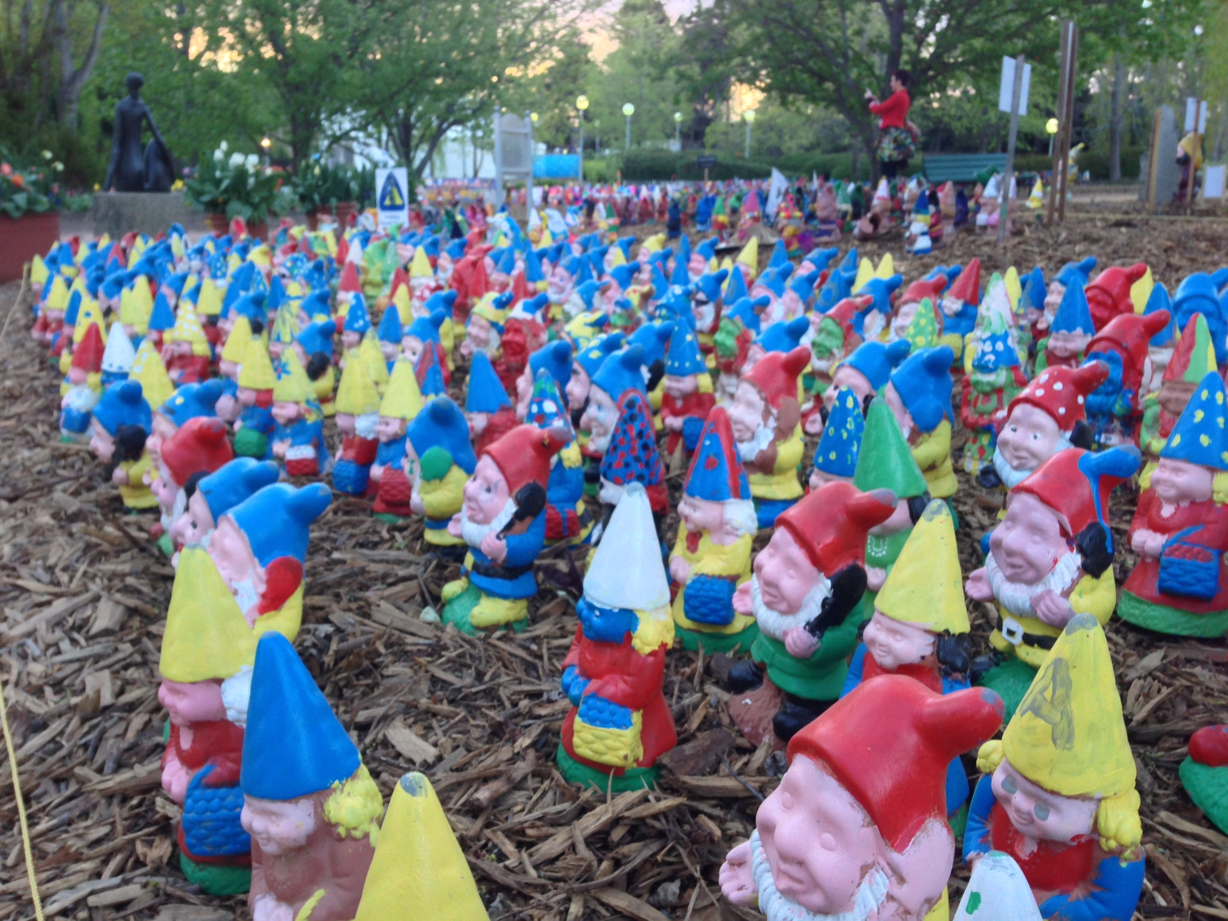 Cal in the distance protected by her army of gnomes.