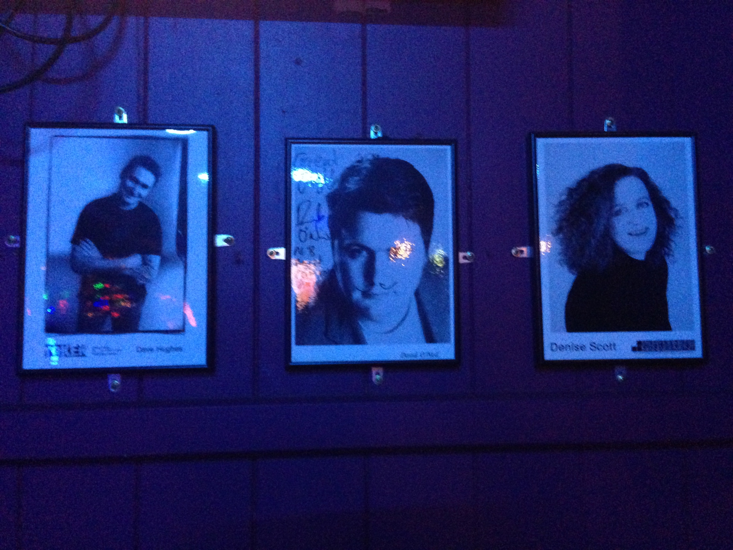 A few of the comedic portraits that dominate the club.