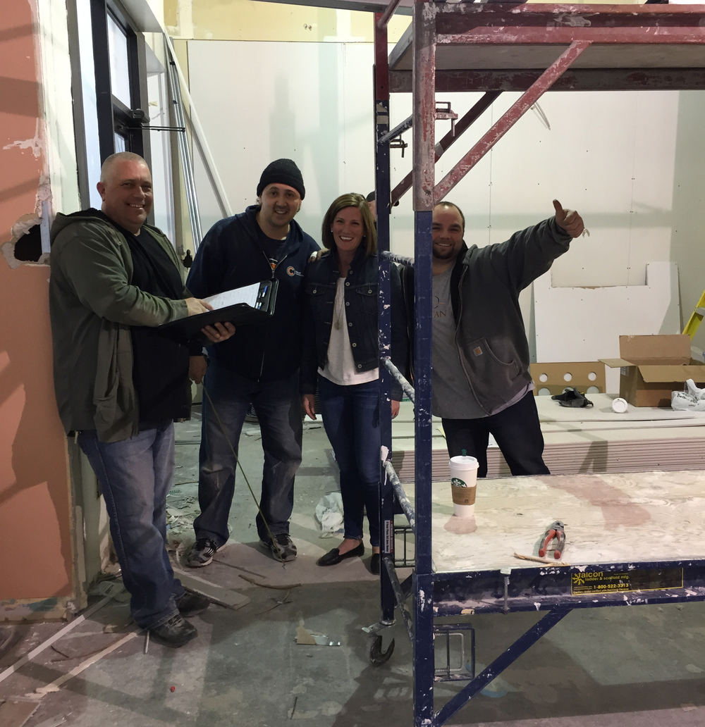 Carolyne and the construction crew, walls are coming up in the new space!