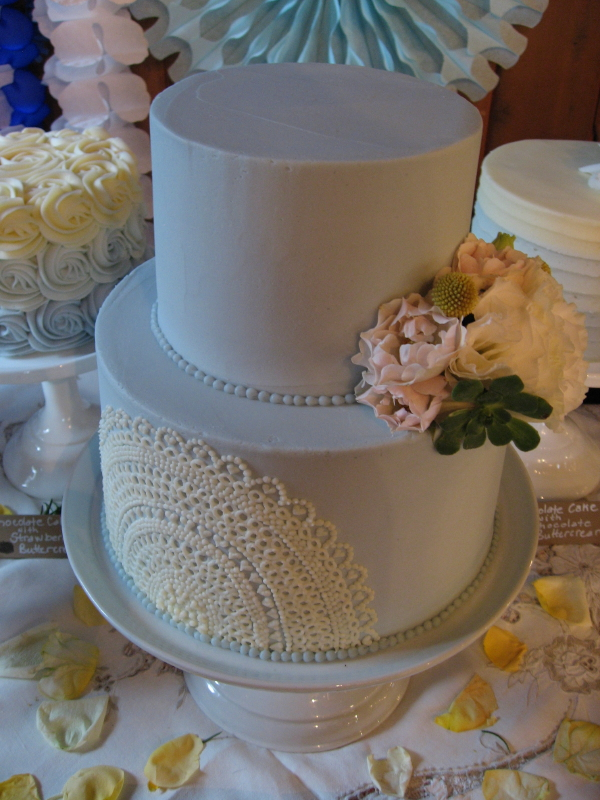 Custom wedding cake with lace buttercream details. This cake was made for an all blue cake table.