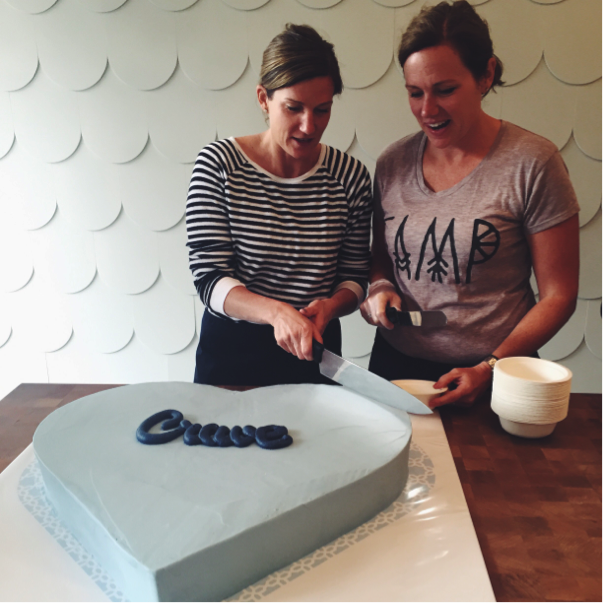 Carolyne and Jodi cutting the cake at our Kensington Grand Opening Celebration. One of our bakers Kelsey, hand lettered the logo in buttercream icing – it worked perfectly.