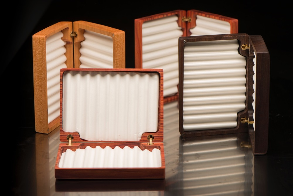 One of a kind book matched fly boxes that will easily hold dozens of dry flies or wet flies. Brass barrel hinge and rippled foam inserts.