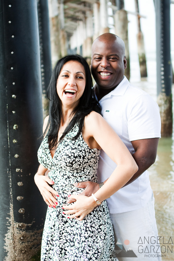 romantic-newport-beach-engagement-session-under-pier-laugh