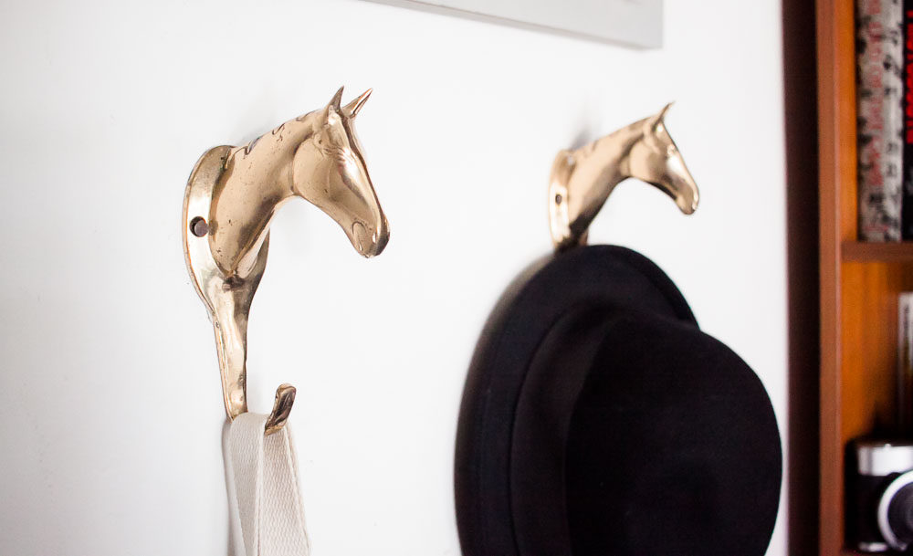 5| BRASS HORSE WALL HOOKS - I found these at Goodwill and I'm obsessed. They totally fit the vibe I'm trying to create in my home office and they're really sturdy. I thought about polishing them up before installing them but I kind of like the tarnished look. Here are some on google if you want your own!