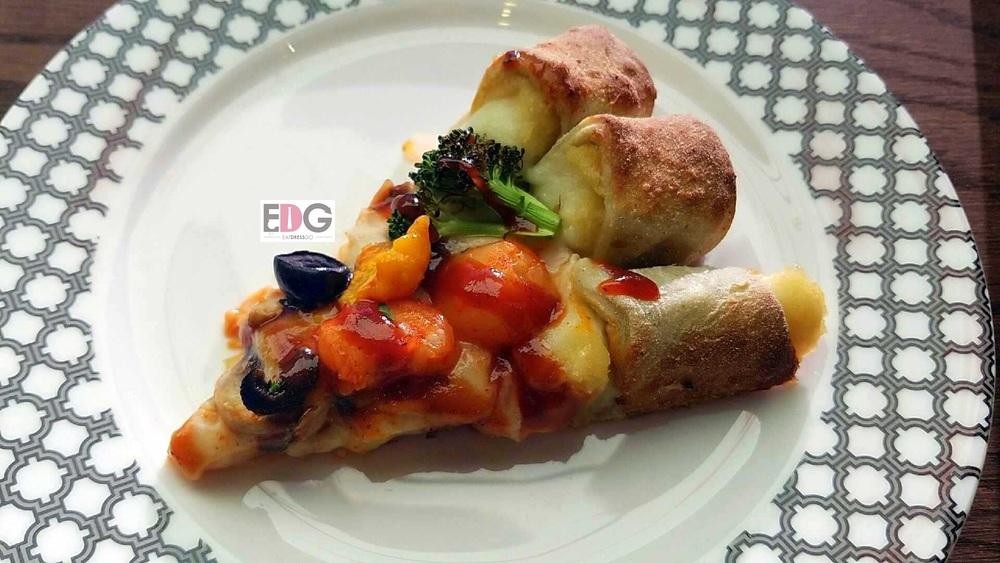 Pizzamaru_ Mango Seafood Slice.jpg