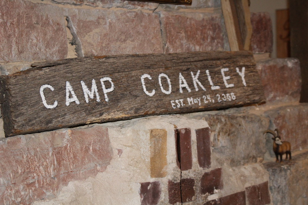 Camp Coakley sign (wedding) displayed over fireplace