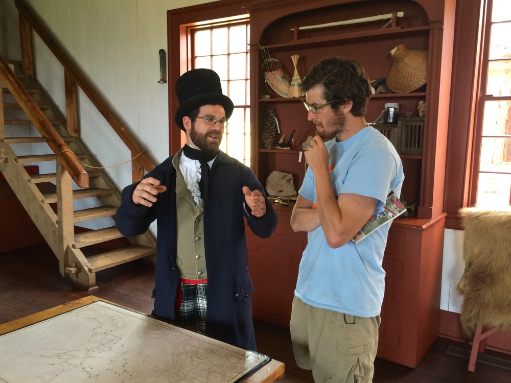 Time traveler wearing a beaver hat while explaining to Darius how important beaver hats were in the 1800s.