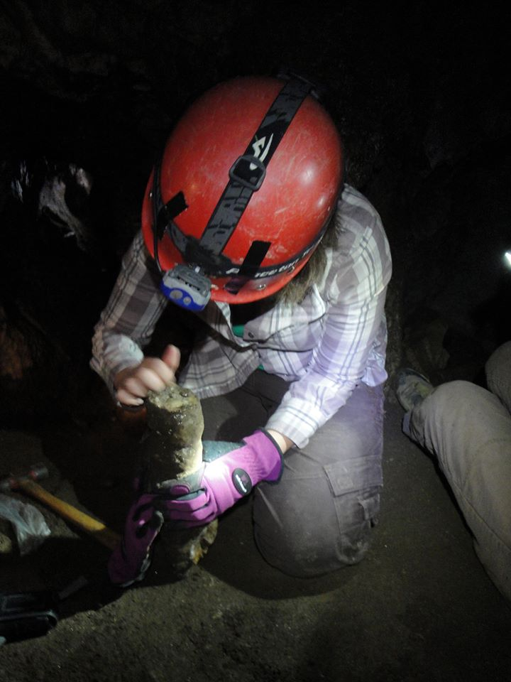 Jessica collects a speleothem from  a California cave.