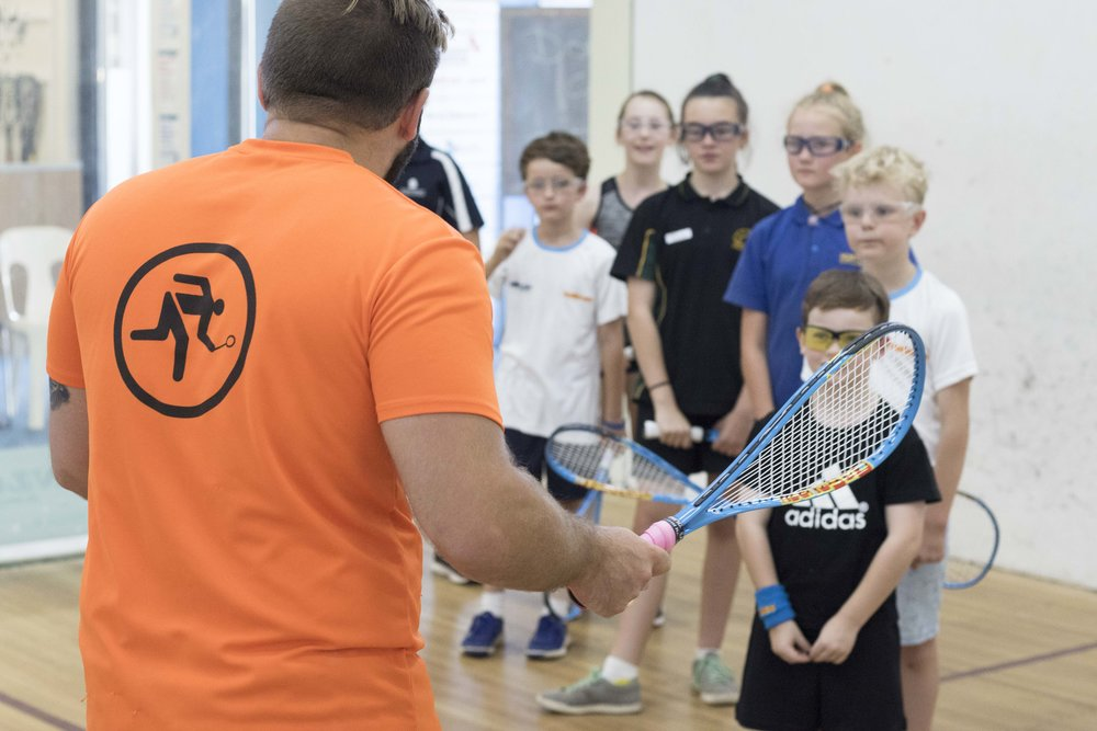 Group training for Juniors is fun and teaches them the basics of squash in a group environment
