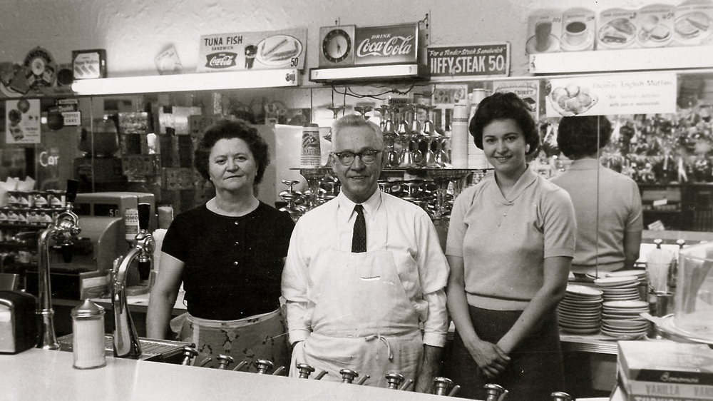 Mr & Mrs Panarites and their daughter Georgia in the Sweet Shop