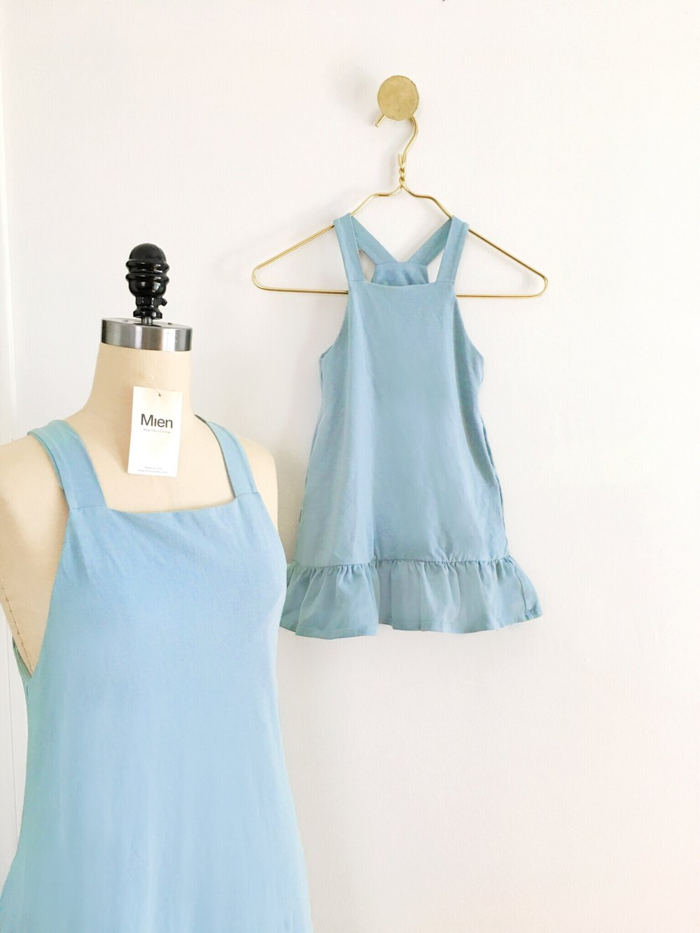 The mama and kiddo pinafore dresses after garment dye - in beautiful powder blue.
