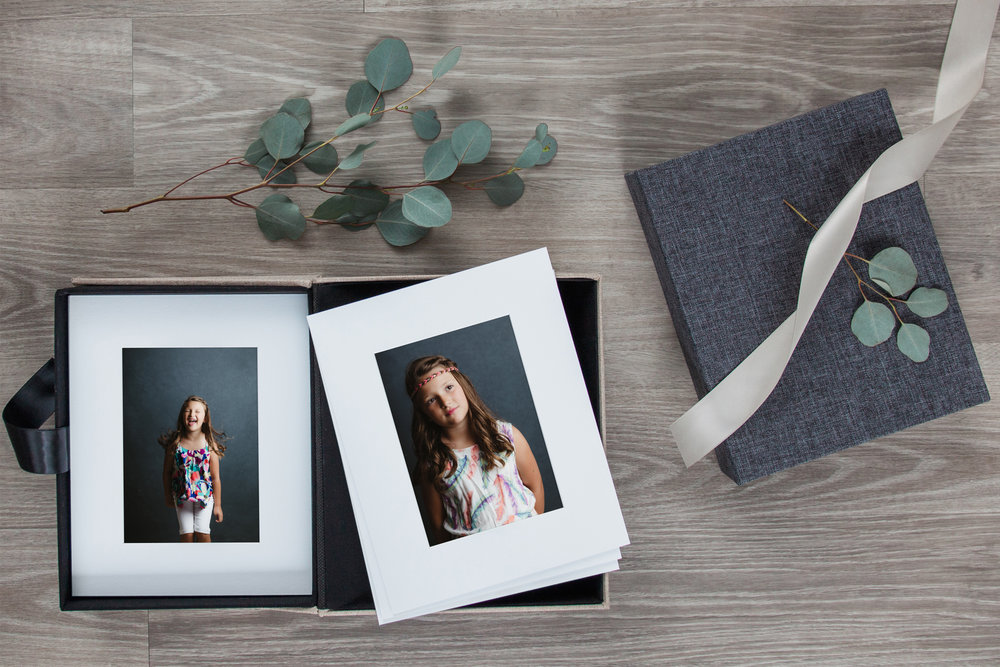 archival portfolio box - Handcrafted, acid-free portfolio boxes are a stunning way to have prints of your favorite images on hand for display or for periodic perusal. The exterior of the box is a work of art in itself, wrapped in your choice of natural or charcoal linen. The images within are matted and ready to be displayed on the included photo easel.10 5x7