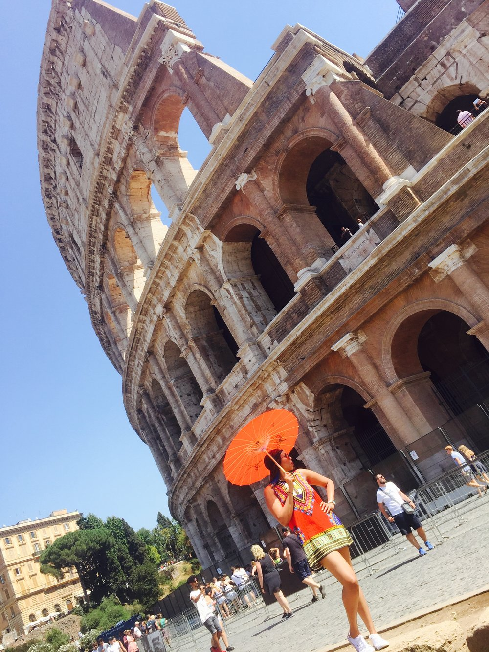 At the Colosseum in Rome, Italy in August.