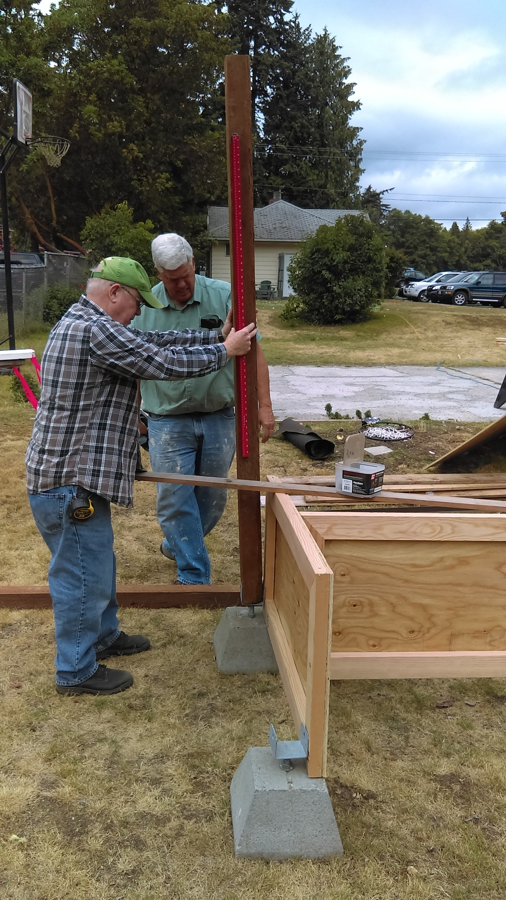 Faithful volunteers Cliff and Dan building our produce stand for our larger Seed to Serve produce to be distributed from.