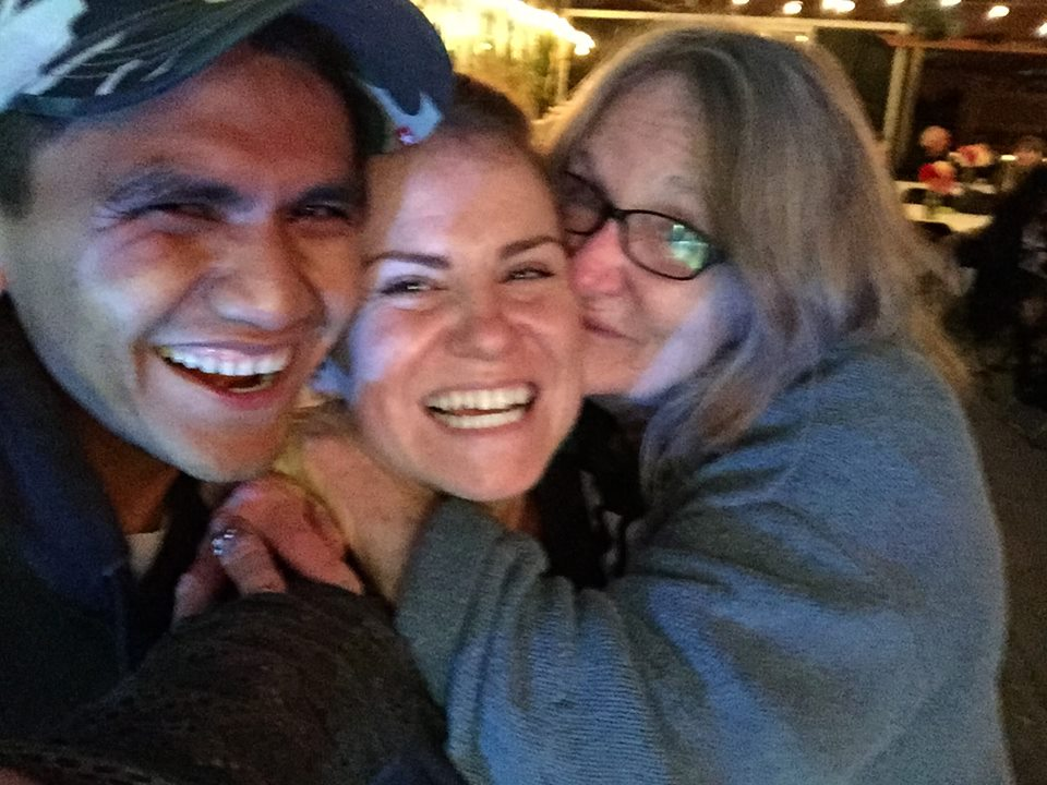 Board member SWHC Judy giving Nekoda and Miguel huge hug for the amazing Taco Feast they put on.