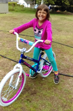 Here is one happy little girl on her new bike.  Grateful we have such a huge yard for our children to play in.