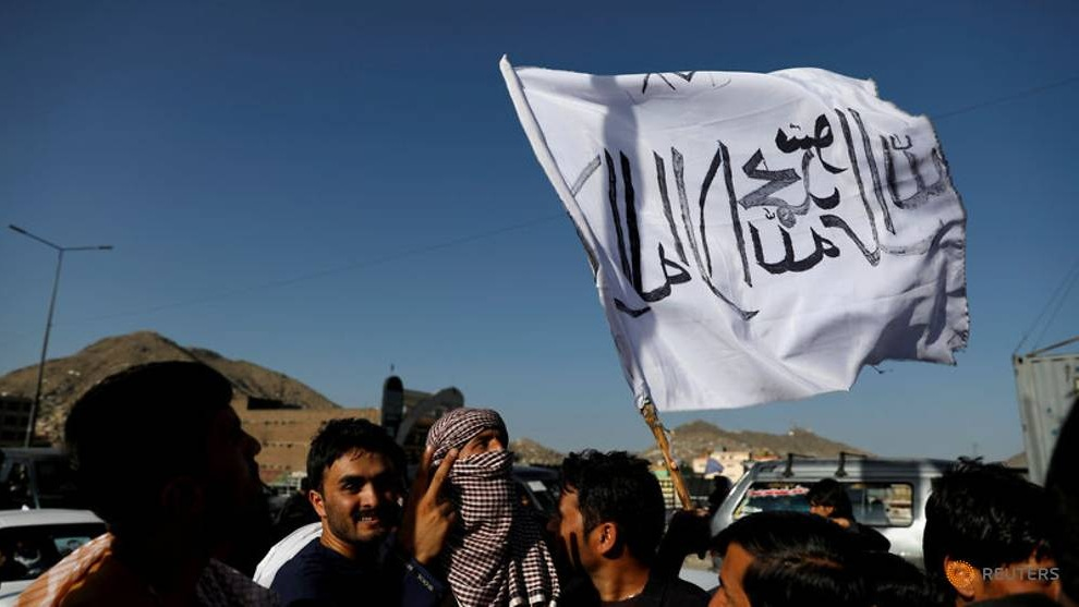 file-photo--a-member-of-the-taliban-holds-a-flag-in-kabul-5.jpg
