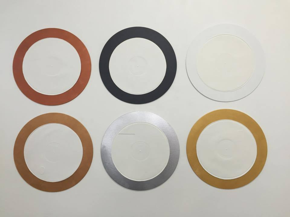 Laura Wilson  Registry - copper, charcoal, white  2015 Embossed vinyl record, hand embossed and cut designs, painted canvas boards size variable