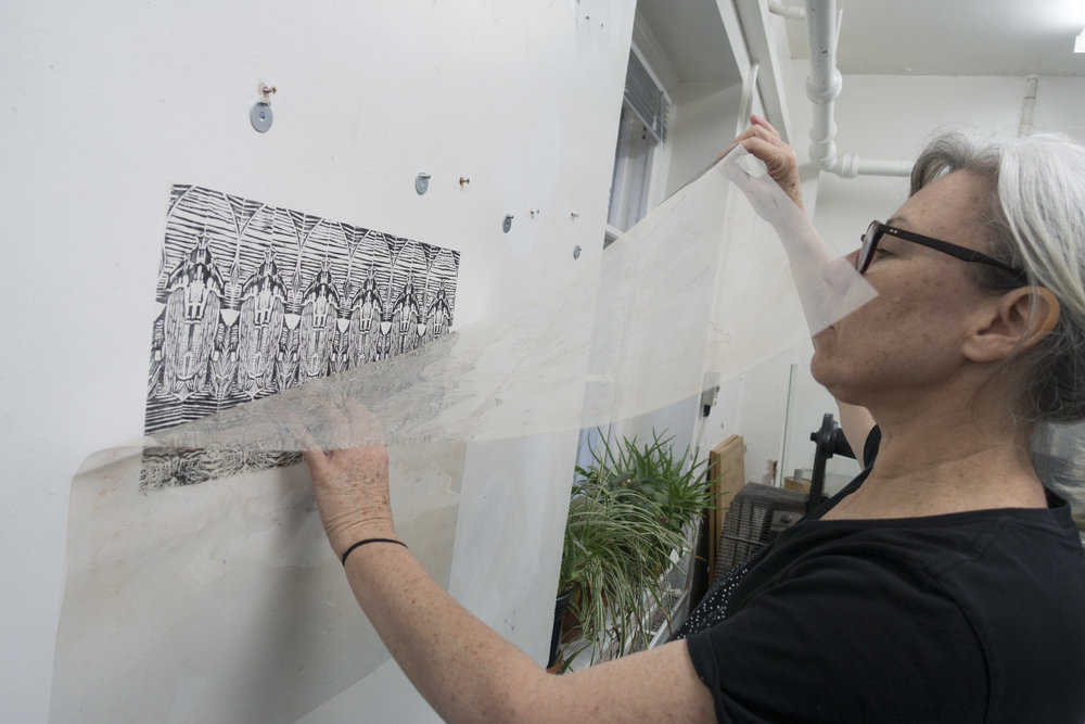 above: Catherine Tempest artist installing work onto the gallery wall - Catherine's work will be a 'paste up' yet to be installed into Gallery 139