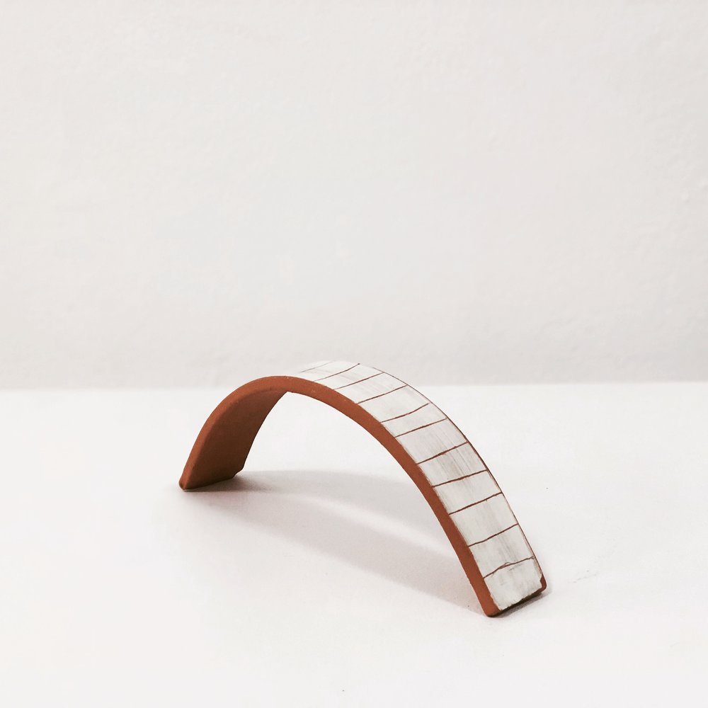 Maddyson Hatton  Arch 2016  terracotta, slip  7 x 18 x 3cm $60.00
