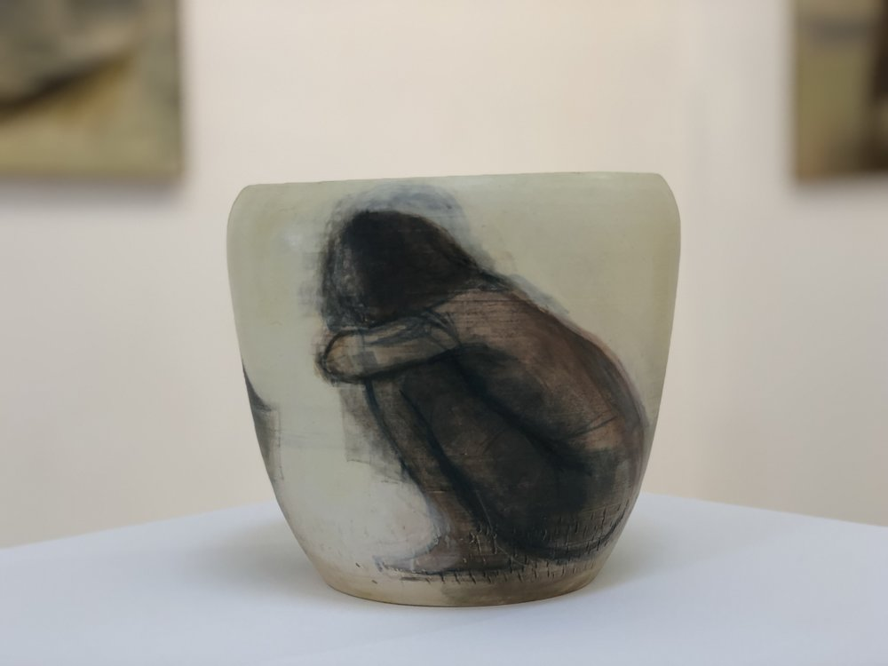The lady laying the net  2018  ceramics  8.5 x 25.5cm diameter SOLD