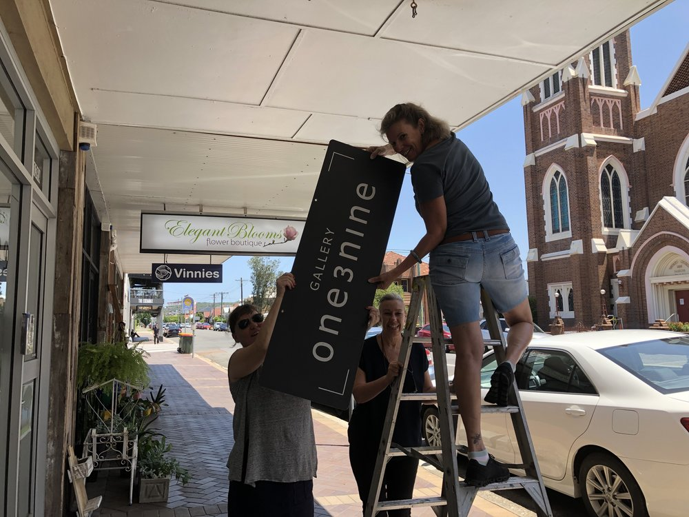 Gallery 139 Volunteers (aka friends) helping to take down out Gallery 139 swing sign