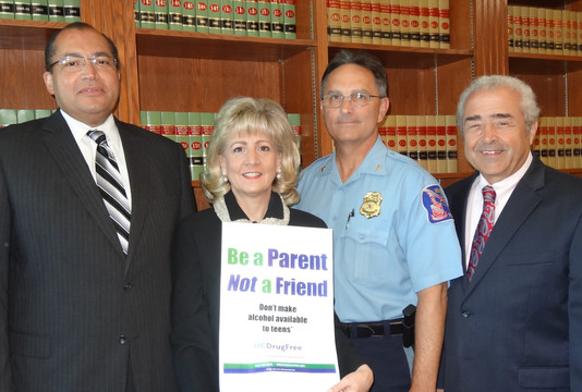 Community leaders working to keep kids off alcohol and other drugs, include, from left, William V. Tucker, Associate Judge, Howard County Circuit Court; Joan Webb Scornaienchi, Executive Director of HC DrugFree and Howard County's Alcohol Coalition Coordinator; Howard County Police Chief Gary Gardner and Howard County State's Attorney Dario Broccolino.