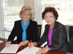 Pictured above: HC DrugFree Executive Director Joan Webb Scornaienchi and President of the Korean Society of MD Seong Ok Baik