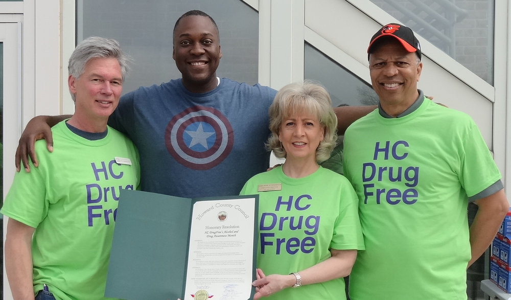 Dr. Calvin Ball (2nd from left) presented HC DrugFree's Executive Director Joan Webb Scornaienchi with a County Council Resolution. Event t-shirt sponsor Dr. Brian Morrison (far left) and Lt. Governor Boyd Rutherford.