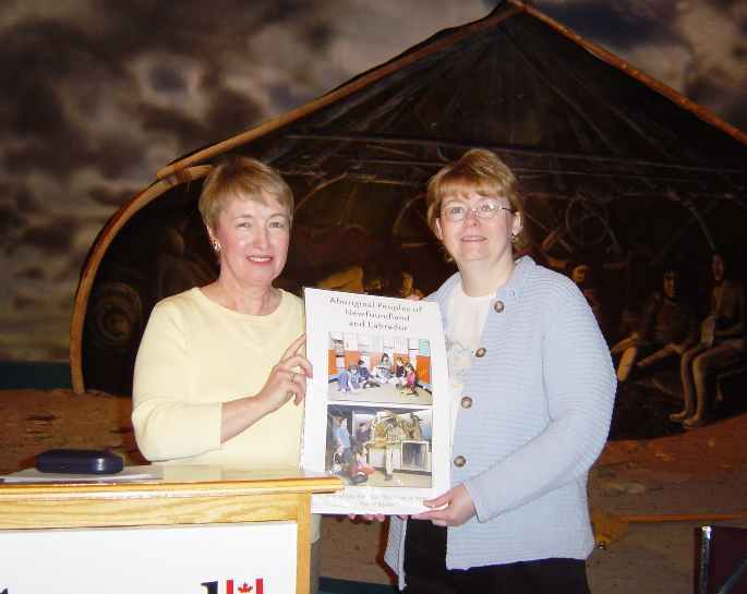 Catherine Power of HSA presents Aboriginal poster series to Brenda Cornick of St. Theresa's Elementary, Port au Choix.