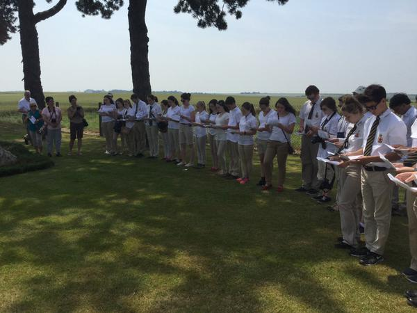Students read aloud the names of the fallen at Gueudecourt