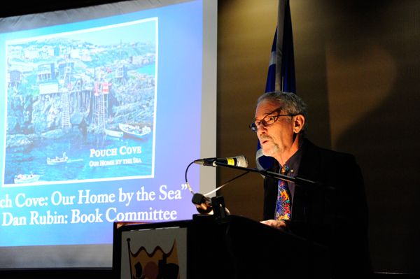 "Mr. Dan Rubin accepts the award on behalf of the Pouch Cove Heritage Society and the book committee who worked on ""Pouch Cove: Our Home by the Sea""."